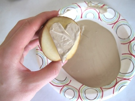 Create your own stamper by cutting into a potato and dipping it into acrylic or craft paint.