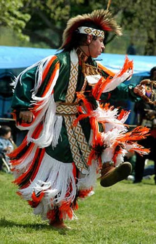 A dancer performs in traditional dress.