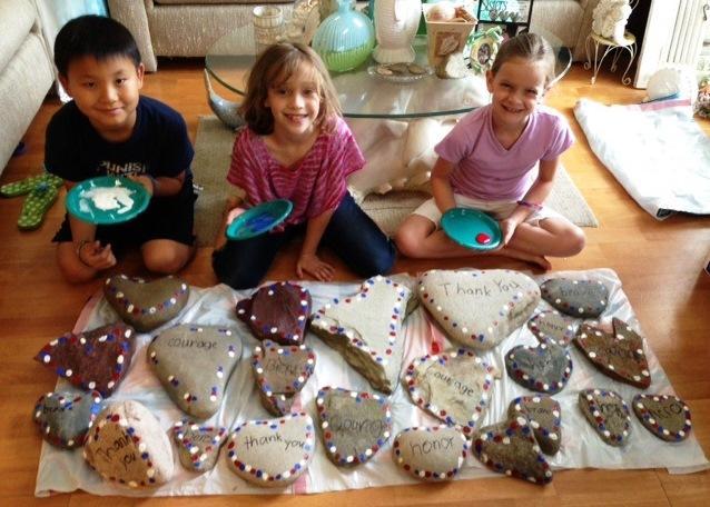 3_kids_painting_heart_rocks